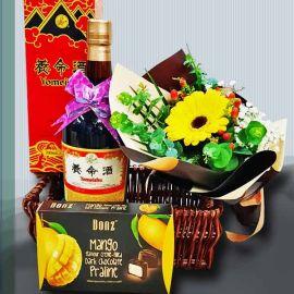 Gerbera with Yomeishu Health Tonic (700ml) and Chocolates in a Basket.