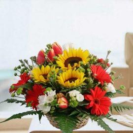 Sunflowers, Tulips & Gerbera Flowers Basket Table Arrangement